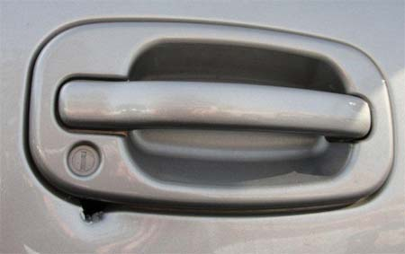 Car Doorhandle showing hole